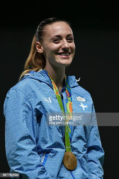 Gold medalist Greece's Anna Korakaki poses on the podium during the medal ceremony of the women's 25m pistol shooting event at the Rio 2016 Olympic...