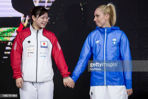 Gold medalist Greek karateka Eleni Chatziliadou and Silver medalist Japanese karateka Ayumi Uekusa congratulate each other on the podium of the 24th...