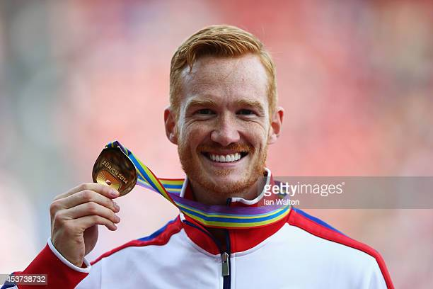 Gold medalist Greg Rutherford of Great Britain and Northern Ireland poses during the medal ceremony for the Men's Long Jump final during day six of...
