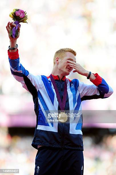 Gold medalist Greg Rutherford of Great Britain pose on the podium for Men's Long Jump on Day 9 of the London 2012 Olympic Games at the Olympic...
