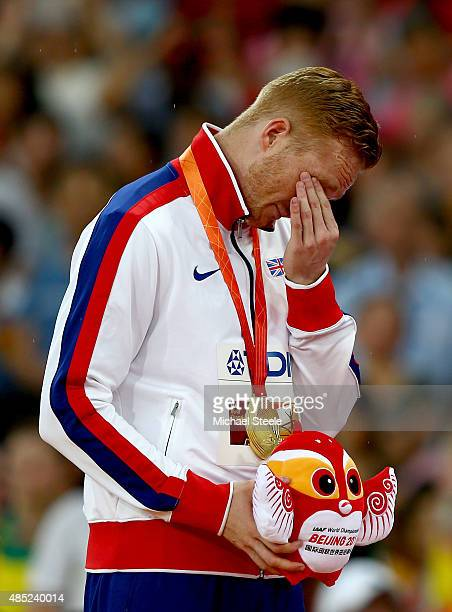 Gold medalist Greg Rutherford of Great Britain shows his emotion on the podium during the medal ceremony for the Men's Long Jump final during day...