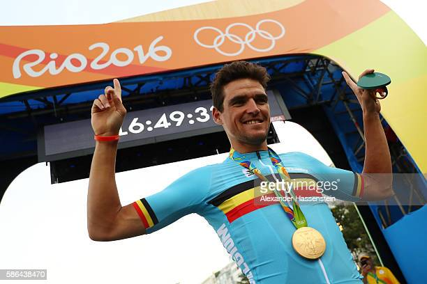 Gold medalist Greg van Avermaet of Belgium celebrates after the medal ceremony for the Men's Road Race on Day 1 of the Rio 2016 Olympic Games at the...