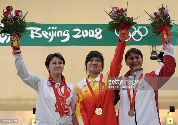 Gold medalist Guo Wenjun of China silver medalist Natalia Paderina of Russia and bronze medalist Nino Salukvadeze of Georgia celebrate on the podium...