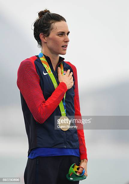 Gold medalist Gwen Jorgensen of the United States stands on the podium during the medal ceremony for the Women's Triathlon with Sugar Loaf Mountain...