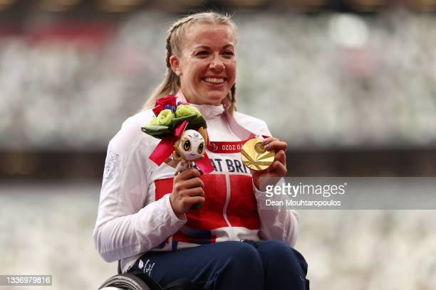 Gold medalist Hannah Cockroft of Team Great Britain poses in the podium after winning Women's 100m T34 on day 5 of the Tokyo 2020 Paralympic Games at...