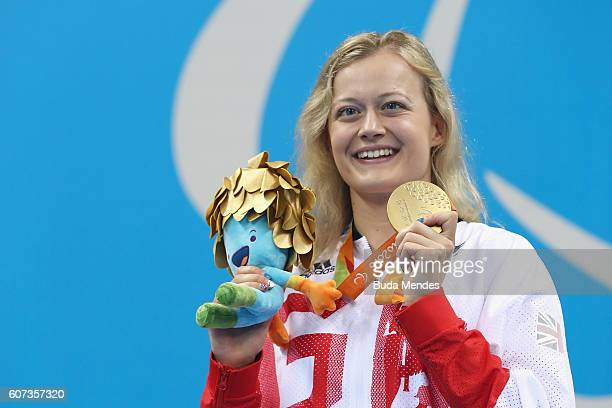 Gold medalist Hannah Russell of Great Britain celebrates on the podium at the medal ceremony for the Women's 50m Freestyle S12 on day 10 of the Rio...
