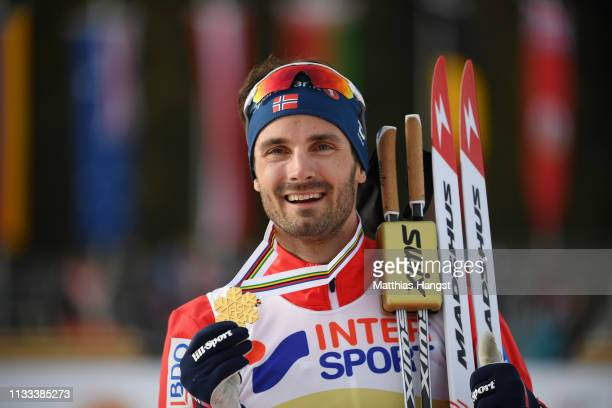 Gold medalist Hans Christer Holund of Norway celebrates during the medal ceremony following Men's Cross Country 50k race during the FIS Nordic World...