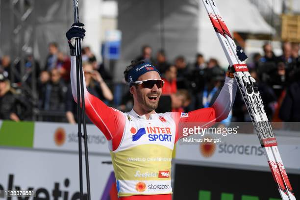 Gold medalist Hans Christer Holund of Norway celebrates following the Men's Cross Country 50k race during the FIS Nordic World Ski Championships on...