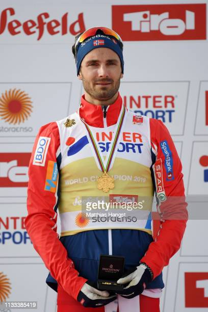 Gold medalist Hans Christer Holund of Norway gets emotional during the medal ceremony following Men's Cross Country 50k race during the FIS Nordic...