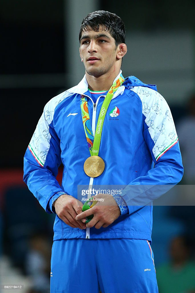 Gold medalist, Hassan Aliazam Yazdanicharati of the Islamic Republic of Iran celebrates on the podium during the medals ceremony after the Men's 74kg Wrestling match on Day 14 of the Rio 2016 Olympic Games at Carioca Arena 2 on August 19, 2016 in Rio de Janeiro, Brazil.