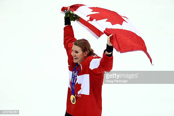 Gold medalist Hayley Wickenheiser of Canada celebrates during the flower ceremony for the Ice Hockey Women's Gold Medal Game on day 13 of the Sochi...