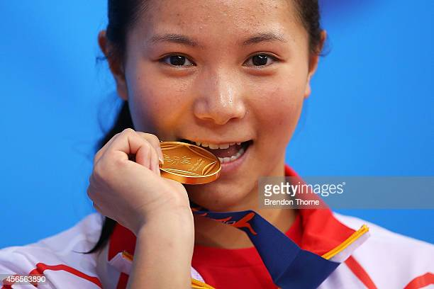 Gold medalist He Zi of China celebrates atop the podium following the Women's 3m Springboard Final during day fourteen of the 2014 Asian Games at...