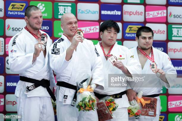 Gold medalist Henk Grol of the Netherlands celebrates with silver medalist Lukas Krpalek of the Czech Republic and bronze medalists Kokoro Kageura of...
