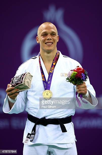 Gold medalist Henk Grol of the Netherlands stands on the podium during the medal ceremony for the Men's Judo 100kg during day fifteen of the Baku...