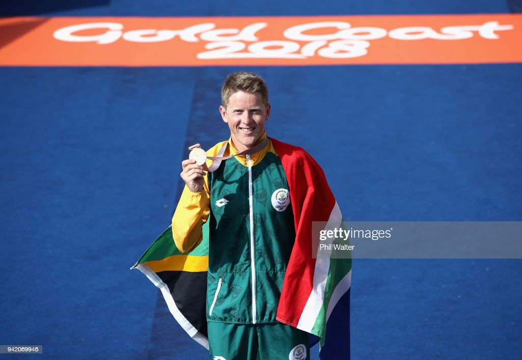 Gold medalist Henri Schoeman of South Africa celebrates during the medal ceremony for the during the Men's Triathlon on day one of the Gold Coast 2018 Commonwealth Games at Southport Broadwater Parklands on April 5, 2018 on the Gold Coast, Australia.