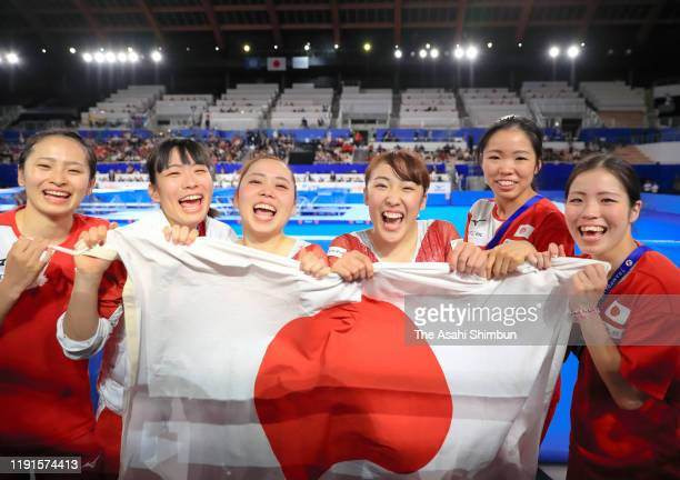 Gold medalist Hikaru Mori of Japan and Silver medalist Chisato Doihata of Japan celebrate with their team mates after competing in the Women's...