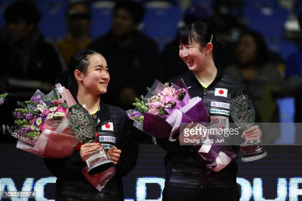Gold medalist Hina Hayata and Mima Ito of Japan celebrate during a ceremony in the Women's Doubles Finals during day four of the World Tour Grand...