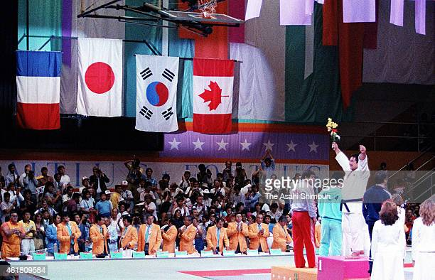 Gold medalist Hitoshi Saito of Japan celebrates on the podium during the medal ceremony for the Men's Judo 95kg during the Los Angeles Olympics on...
