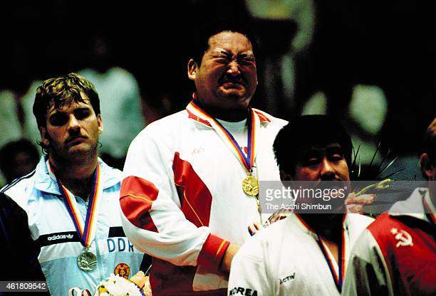 Gold medalist Hitoshi Saito of Japan sheds tears with joy during the medal ceremony for the Men's Judo 95kg during the Seoul Olympics at Jangchung...