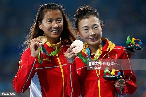 Gold medalist, Hong Liu of China, and bronze medalist Xiuzhi Lu of China, pose on the podium during the medal ceremony for the Women's 20km Race walk...