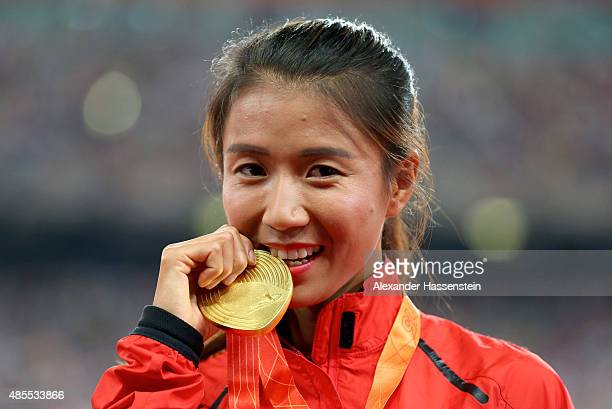 Gold medalist Hong Liu of China poses on the podium during the medal ceremony for the Women's 20km Race Walk final during day seven of the 15th IAAF...