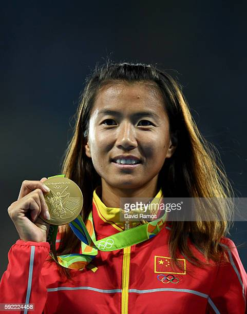 Gold medalist, Hong Liu of China, poses on the podium during the medal ceremony for the Women's 20km Race walk on Day 14 of the Rio 2016 Olympic...