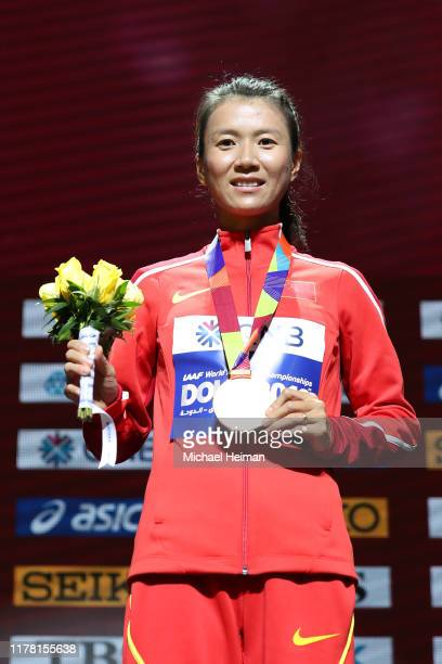 Gold medalist Hong Liu of China stands on the podium during the medal ceremony for the Women's 20km Race Walk final during day four of 17th IAAF...