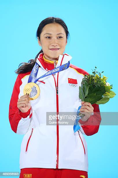 Gold medalist Hong Zhang of China celebrates during the medal ceremony for the Speed Skating Women's 1000m on day 7 of the Sochi 2014 Winter Olympics...