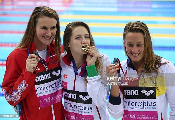 Gold medalist Hungary's Boglarka Kapas poses for a photograph with silver medalist Britain's Jazmin Carlin and bronze medalist Spain's Mireia...