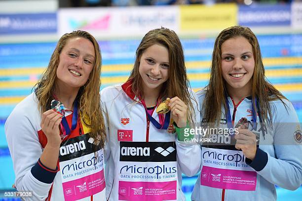 Gold medalist Hungary's Boglarka Kapas poses with silver medalist Spain's Mireia Belmonte Garcia and bronze medalist Spain's Maria Vilas Vidal after...