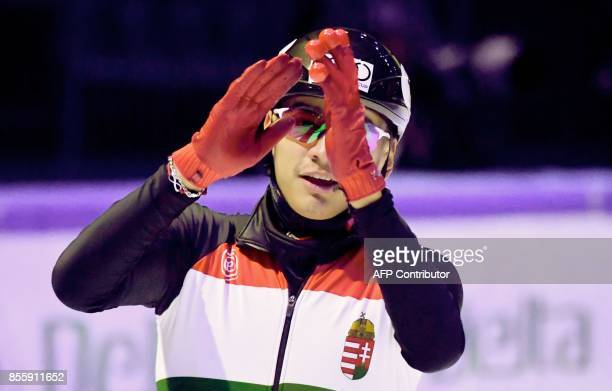 Gold medalist Hungary's Shaolin Sandor Liu celebrates after the final of the Men's 500m race during the ISU Short Track Speed Skating World Cup at...