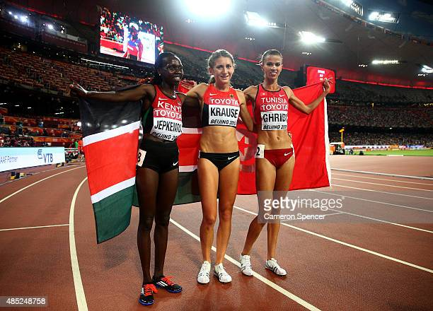 Gold medalist Hyvin Kiyeng Jepkemoi of Kenya bronze medalist Gesa Felicitas Krause of Germany and silver medalist Habiba Ghribi of Tunisia celebrate...