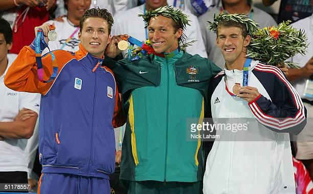 Gold medalist Ian Thorpe of Australia silver medalist Pieter Van Den Hoogenband of the Netherlands and bronze medalist Michael Phelps of USA pose...