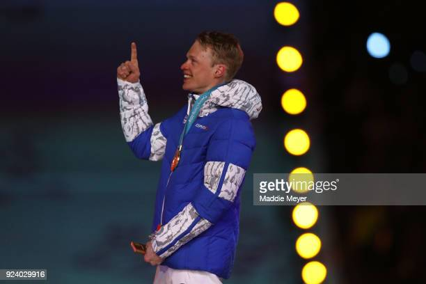 Gold medalist Iivo Niskanen of Finland poses during the medal ceremony for the CrossCountry Skiing Men's 50km Mass Start Classic during the Closing...