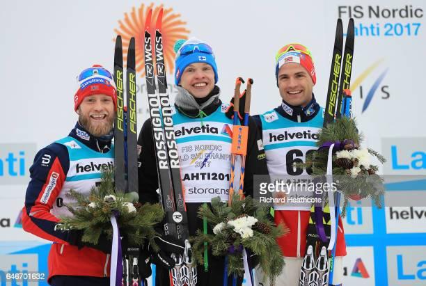Gold Medalist Iivo Niskanen of Finland Silver Medalist Martin Johnsrud Sundby of Norway and Bronze Medalist Niklas Dyrhaug of Norway celebrate...