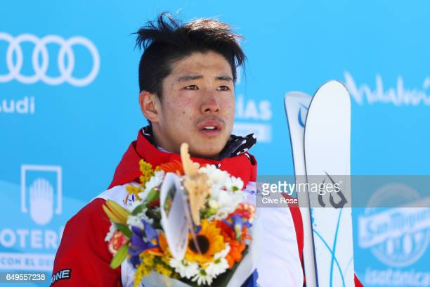 Gold medalist Ikuma Horishima of Japan poses during the flower ceremony for the Men's Moguls on day one of the FIS Freestyle Ski Snowboard World...