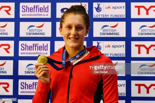 Gold medalist Imogen Clark of Loughboro University poses with the medal won in the Womens Open 50m Breaststroke final on day one of the British...