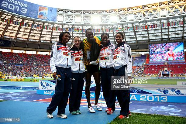 Gold medalist in the Men's 200 metres Usain Bolt of Jamaica poses with Bronze medalists in the 4x400 metres Women's relay Margaret Adeoye, Eilidh...