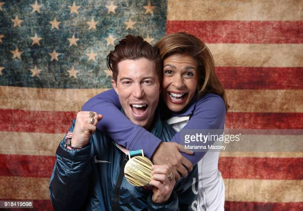 Gold medalist in the Men's Snowboard Halfpipe Shaun White of the United States poses for a portrait with host Hoda Kotb on the Today Show Set on...