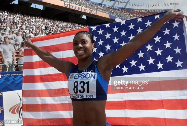Gold medalist in the women's 100M hurdles Anjanette Kirkland of the US celebrates her win during the 8th World Championships in Athletics 11 August...
