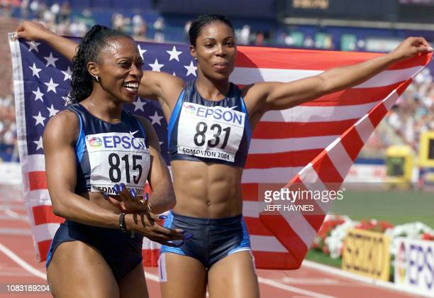Gold medalist in the women's 100M hurdles Anjanette Kirkland of the US celebrates with teammate and silver medal winner Gail Devers after their wins...
