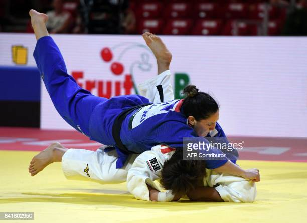 Gold medalist in the womens 78kg category Brasil's Mayra Aguiar competes with Japan's Mami Umeki at the World Judo Championships in Budapest on...