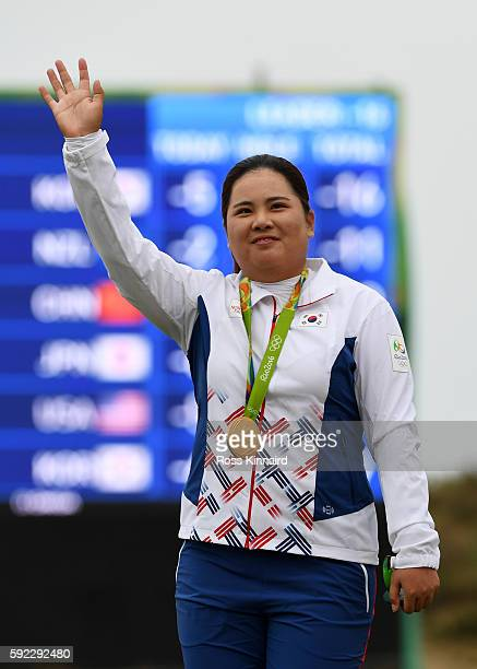 Gold medalist, Inbee Park of Korea poses on the podium during the medal ceremony for Women's Golf on Day 15 of the Rio 2016 Olympic Games at the...