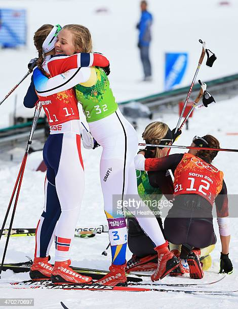 Gold medalist Ingvild Flugstad Oestberg of Norway embraces bronze medalist Stina Nilsson of Sweden after the Women's Team Sprint Classic Final during...