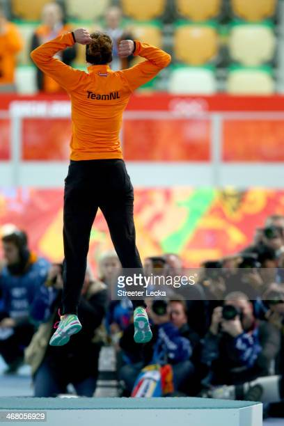 Gold medalist Irene Wust of the Netherlands celebrates on the podium during the flower ceremony for the Women's 3000m Speed Skating event during day...