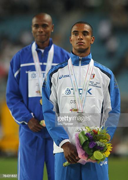 Gold medalist Irving Saladino of Panama and silver medalist Andrew Howe of Italy receive their medals for the Men's Long Jump on day seven of the...