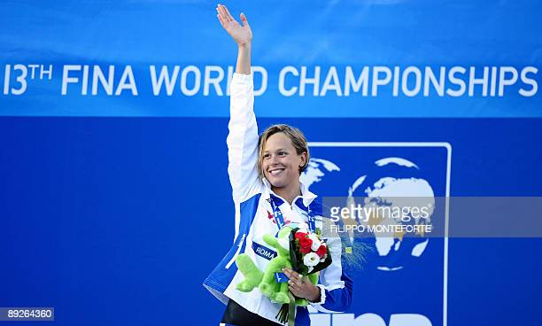 Gold medalist Italy's Federica Pellegrini celebrates on the podium of the Women's 400m freestyle on July 26 2009 at the 13th FINA World Swimming...