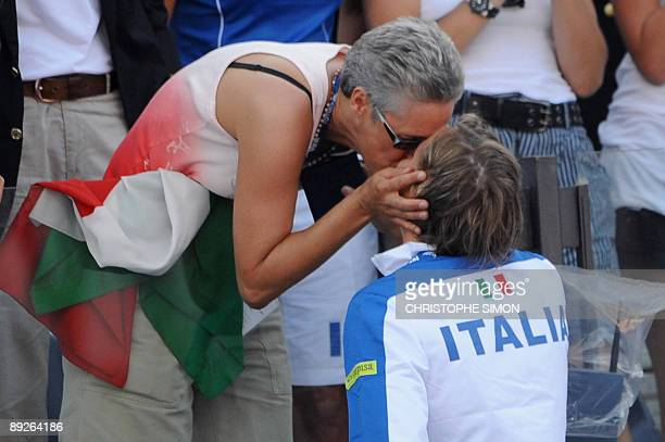Gold medalist Italy's Federica Pellegrini is kissed by her mother after the podium of the Women's 400m freestyle on July 26 2009 at the 13th FINA...