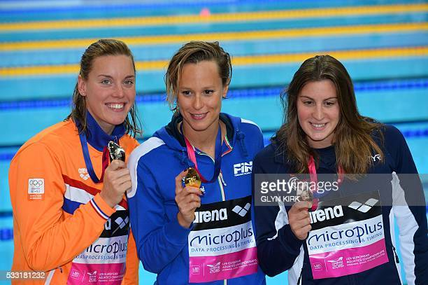 Gold medalist Italy's Federica Pellegrini poses for a photograph with silver medalist Netherlands' Femke Heemskerk and bronze medalist France's...