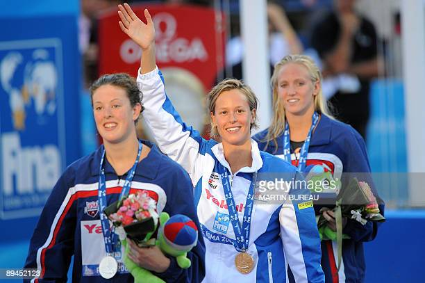 Gold medalist Italy's Federica Pellegrini silver medalist United States's Allison Schmitt and bronze medalist USA's Dana Vollmer celebrate on the...